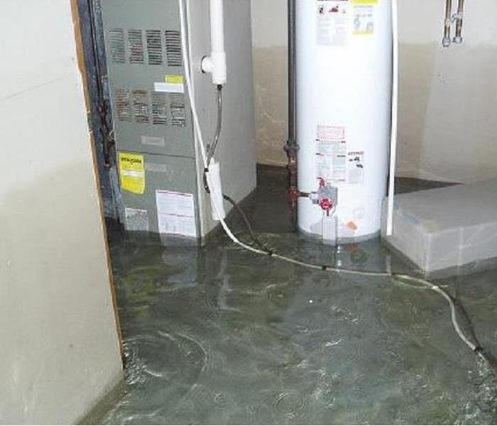A flooded basement with water ankle deep after a storm