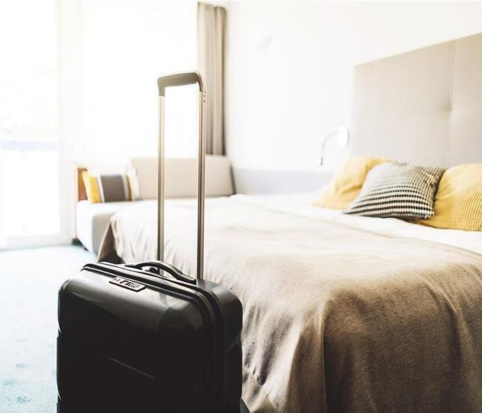 Beautiful modern hotel room and suitcase